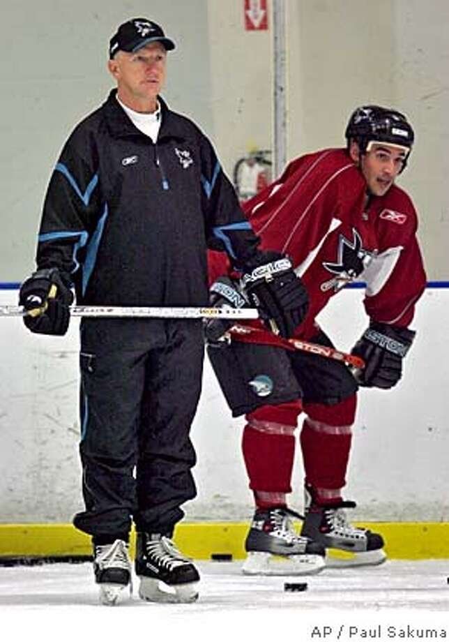 San Jose Sharks head coach Ron Wilson, left, and right wing Jonathan Cheechoo, right, watch practice at the San Jose Sharks practice facility in San Jose, Calif., Tuesday, Sept. 13, 2005, on the first day of training camp. (AP Photo/Paul Sakuma) STAND ALONE PHOTO Photo: PAUL SAKUMA