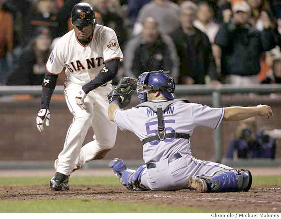 San Francisco Giants Pedro Feliz (7) is out at homeplate on a double by San Francisco Giants Randy Winn (2) in the 5th inning. Los Angeles Dodgers catcher Russell Martin (55) is at right.  The San Francisco Giants host the Los Angeles Dodgers at AT&T Park in San Francisco, CA on Friday night, April 6, 2007.  Photo by Michael Maloney / San Francisco Chronicle ***(Roster) Russell Martin, Randy Winn, Pedro Feliz Photo: Michael Maloney
