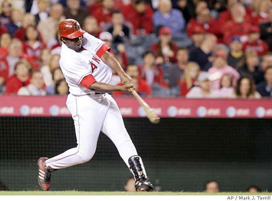 Los Angeles Angels' Vladimir Guerrero connects for a three-run home run during the seventh inning of a baseball game against the Oakland Athletics on Friday, April 6, 2007, in Anaheim, Calif. (AP Photo/Mark J. Terrill) Photo: Mark J. Terrill
