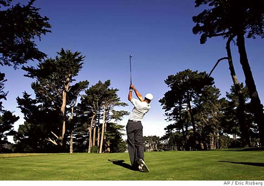 Tiger Woods tees off on the 15th hole during a practice round for the American Express World Golf Championships at Harding Park in San Francisco, Tuesday, Oct. 4, 2005. (AP Photo/Eric Risberg) Photo: ERIC RISBERG