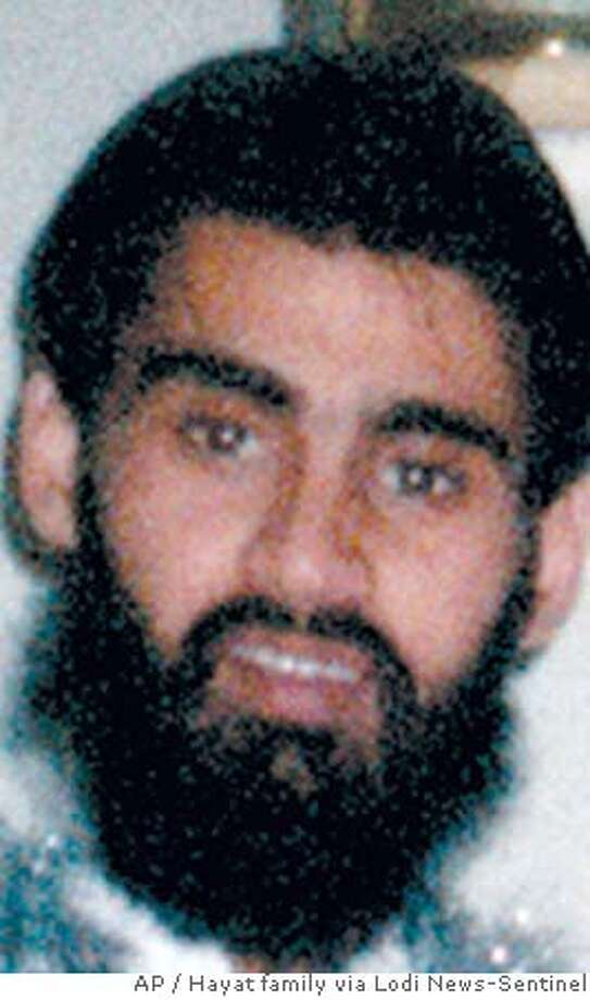 """This is an undated photo of Hamid Hayat provided by the Hayat family. Hayat, who is facing federal terrorism charges, """"had a jihadi heart and a jihadi mind"""" long before he confessed to attending an al-Qaida training camp in Pakistan, assistant U.S. Attorney Robert Tice-Raskin said during his closing argument Wednesday, April 12, 2006. Hayat's attorney argued that the government does not have a case because it has no proof that her client ever went to a terrorist training camp. (AP Photo/Hayat family via Lodi News-Sentinel) ** MAGS OUT NO SALES **Ran on: 04-14-2006  Umer HayatRan on: 04-14-2006  Ran on: 04-14-2006  Umer HayatRan on: 04-14-2006  Ran on: 04-26-2006  Johnny Griffin (left), Umer Hayat's attorney, and Wazhma Mojaddidi, Hamid Hayat's lawyer, address the media after the verdicts.Ran on: 04-26-2006  Johnny Griffin (left), Umer Hayat's attorney, and Wazhma Mojaddidi, Hamid Hayat's lawyer, address the media after the verdicts.Ran on: 04-26-2006 Ran on: 05-04-2006  Hamid Hayat  Ran on: 05-20-2006  Hamid Hayat  Ran on: 06-01-2006  Umer Hayat and his attorney Johnny Griffin talk with reporters. Hayat is to be sentenced to time served and three years' probation.  Ran on: 06-01-2006  Umer Hayat and his attorney Johnny Griffin talk with reporters. Hayat is to be sentenced to time served and three years' probation. NO SALES MAGS OUT BEST QUALITY Photo: Courtesy Hayat Family"""