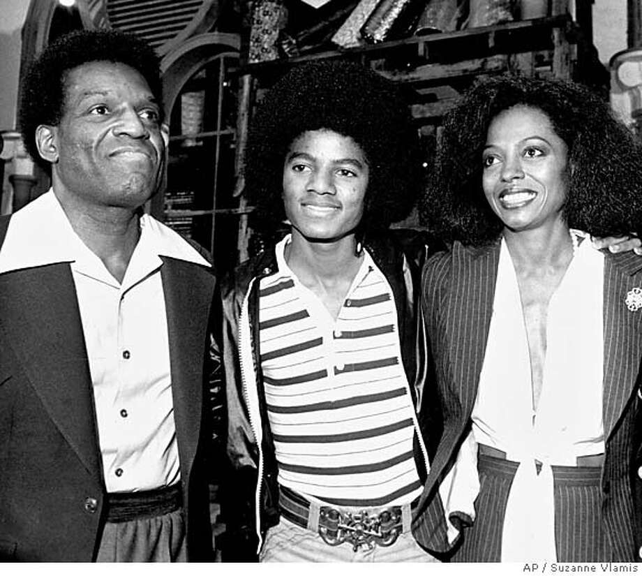 """** FILE ** Stars of the """"The Wiz,"""" a film adaptation of the Broadway musical of the same title, pose at a news conference in New York City, Sept. 28, 1977. From left are, Nipsey Russell, Michael Jackson, and Diana Ross. Russell, who played the Tin Man alongside Ross and Jackson in """"The Wiz,"""" as part of a decades-long career in stage, television and film, died Sunday afternoon Oct. 2, 2005 at Lenox Hill Hospital, said his longtime manager Joseph Rapp. (AP Photo/Suzanne Vlamis) Photo: SUZANNE VLAMIS"""
