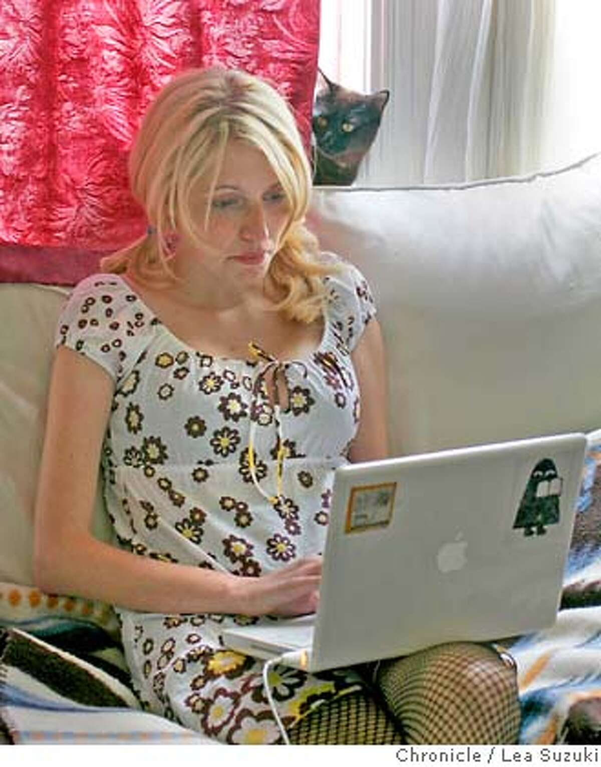 spyspace_009_ls.JPG Angela Petrella, a Spyspace user, at her home with her laptop on Sunday, April 1, 2007. Photo taken on 4/1/07, in San Francisco, CA. Photo by Lea Suzuki/ The Chronicle (Angela Petrella)cq MANDATORY CREDIT FOR PHOTOG AND SF CHRONICLE/NO SALES-MAGS OUT.