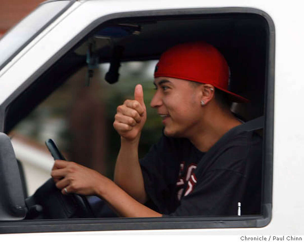 An unidentified passing motoristt gives a thumbs-up to teachers walking a picket line at Hayward High School on the first day of a teachers' strike in Hayward, Calif. on Thursday, April 5, 2007. PAUL CHINN/The Chronicle