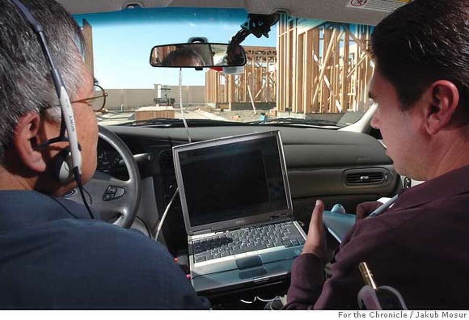 Maps03_03_JMM.JPG  Will Wong and Mark Chilianis, of Navteq, drive while collecting data for street maps used by such companies as Yahoo and transportation agencies. Company has teams of map data collectors who drive around the country getting street names and figuring out routes.  Event on 9/28/05 in San Francisco. JAKUB MOSUR / The Chronicle MANDATORY CREDIT FOR PHOTOG AND SF CHRONICLE/ -MAGS OUT Photo: JAKUB MOSUR