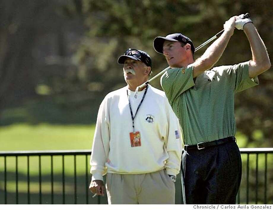 """Jim Furyk and his caddie, Mike """"Fluff"""" Cowan, watch Furyk's drive on the driving range at Harding Park Golf Course before Furyk took a practice round on the back nine. Several PGA golfers showed up on Monday, October 3, 2005, for a practice day for the American Express Championship at Harding Park Golf Course in San Francisco, Ca. Photo by Carlos Avila Gonzalez / The San Francisco Chronicle  Photo taken on 10/3/05, in San Francisco,CA. Photo: Carlos Avila Gonzalez"""