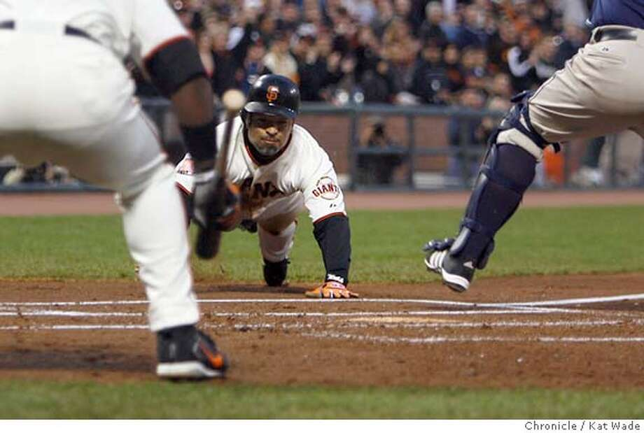 GIANTS_205c_KW.jpg  The Giant's Omar Vizquel slides into home past the Padre's catcher Josh Bard to scor off of a Barry Bond's double in the first inning on Thursday April 5, 2007 when the San Francisco Giants play the San Diego Padres at AT&T Park in San Francisco. Kat Wade/The Chronicle  Ran on: 04-06-2007  Omar Vizquel helps get the Giants off to a fast start, scoring on a double by Barry Bonds in the first inning.  Ran on: 04-06-2007  Dave Roberts helps get the Giants off to a fast start, scoring on a double by Barry Bonds in the first inning. Photo: Kat Wade