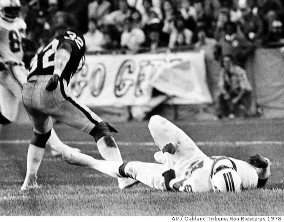 New England Patriots Darryl Stingley lays on the ground after a hit by Oakland Raiders Jack Tatum (32) during an NFL preseason football game in Oakland, Calif., Aug. 12, 1978. Stingley, who was paralyzed on the play nearly 30 years ago, died Thursday, April 5, 2007. He was 55. (AP Photo/Oakland Tribune, Ron Riesterer) **NO SALES MAGS OUT NO INTENET NO ARCHIVE** Photo: RON RIESTERER