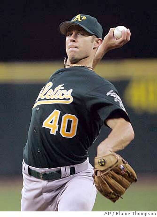 Oakland Athletics starting pitcher Rich Harden throws against the Seattle Mariners in the first inning at a baseball game, Wednesday, April 4, 2007, in Seattle. (AP Photo/Elaine Thompson) Photo: Elaine Thompson