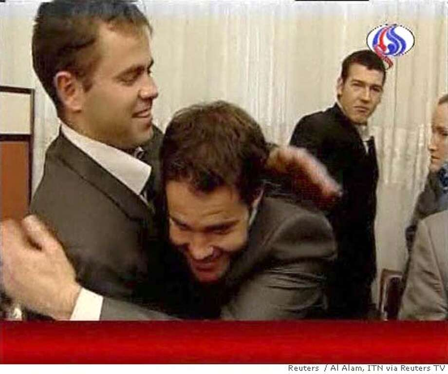 "Video grab shows captured British servicemen hugging as they receive news that they are to be freed, before being taken to meet Iranian President Mahmoud Ahmedinejad, in Tehran April 4, 2007. Ahmadinejad said on Wednesday he would free 15 British sailors and marines, making Britain a ""gift"" in a surprise announcement that ended a crisis which rattled world financial markets. REUTERS/Al Alam/ITN via REUTERS TV (IRAN) IRAN OUT UK OUT ABC (Australia) OUT TVNZ OUT UK INTERNET SITES OUT TEMPLATE OUT. EDITORIAL USE ONLY. NOT FOR SALE FOR MARKETING OR ADVERTISING CAMPAIGNS. NO ARCHIVES. NO SALES. EUO NARCH NOSALES Photo: REUTERS TV"