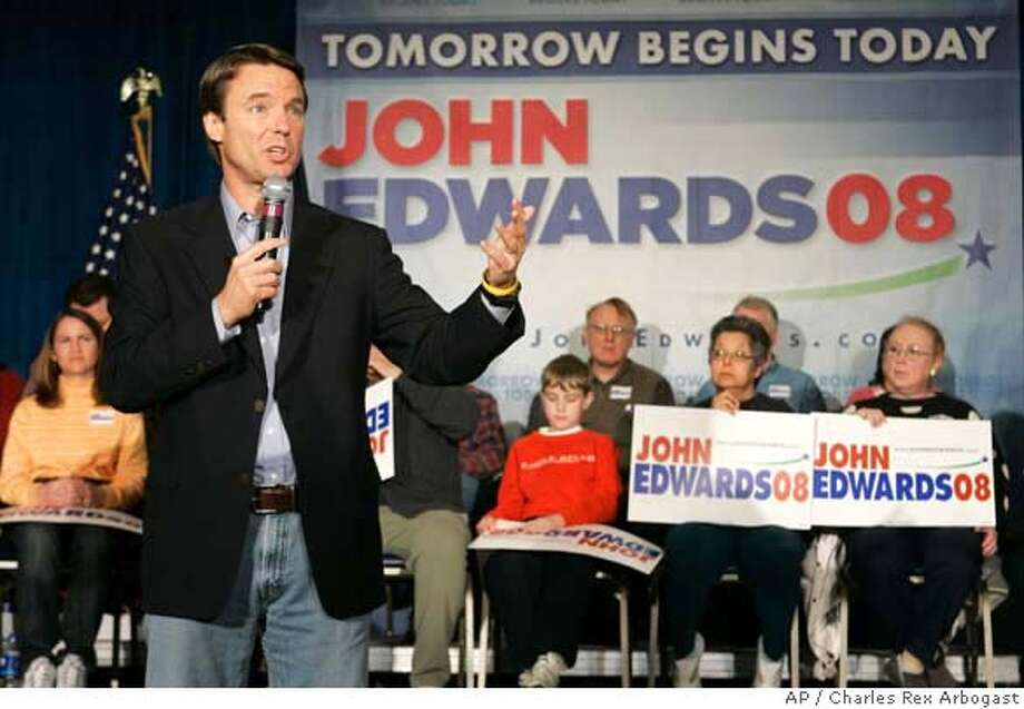 Democratic Presidential hopeful John Edwards conducts a campaign town hall meeting in Davenport, Iowa, Wednesday, April 4, 2007. (AP Photo/Charles Rex Arbogast) Photo: Charles Rex Arbogast