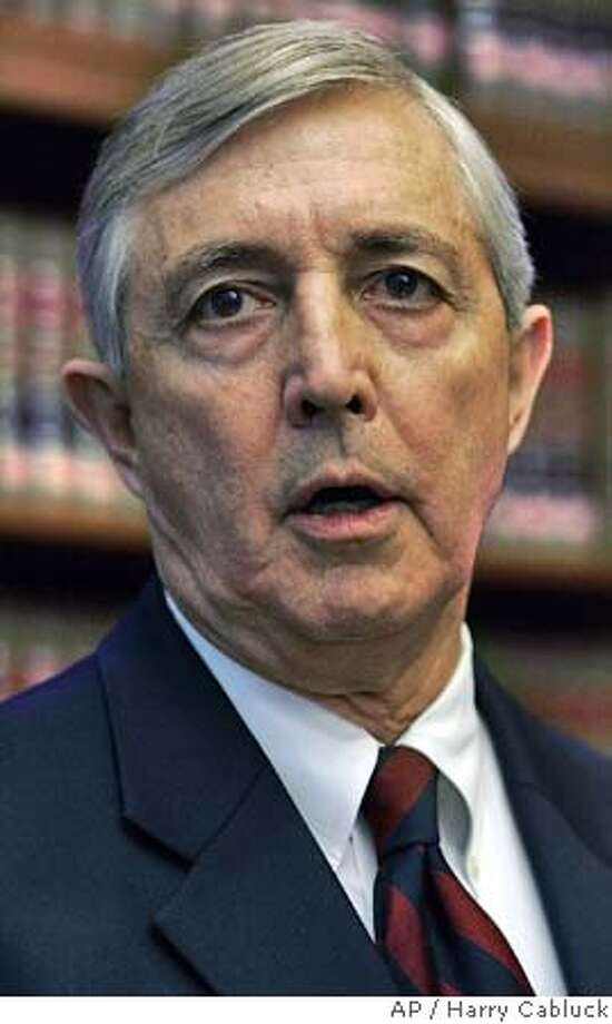 Travis County District Attorney Ronnie Earle speaks during a news conference after a grand jury on Wednesday, Sept. 28, 2005, in Austin, Texas, charged Rep. Tom DeLay and two political associates with conspiracy in a campaign finance scheme. (AP Photo/Harry Cabluck) Photo: HARRY CABLUCK