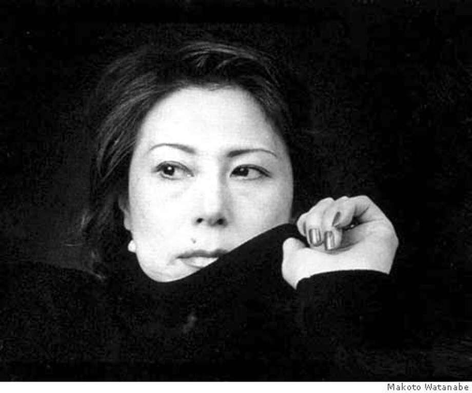 "� Natsuo Kirino and cover of her book ""Grotesque'."" Credit: Makoto Watanabe Photo: Makoto Watanabe"