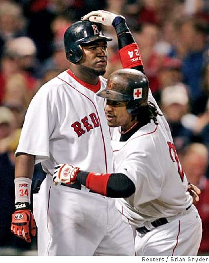 Boston Red Sox's David Ortiz (L) and Manny Ramirez celebrate after scoring on Ramirez's two-run home run in the sixth inning against Toronto Blue Jays at Fenway Park in Boston, Massachusetts, September 29, 2005. Red Sox beat the Blue Jays 5-4 on an Ortiz RBI single in the bottom of the ninth inning. REUTERS/Brian Snyder 0 Photo: BRIAN SNYDER