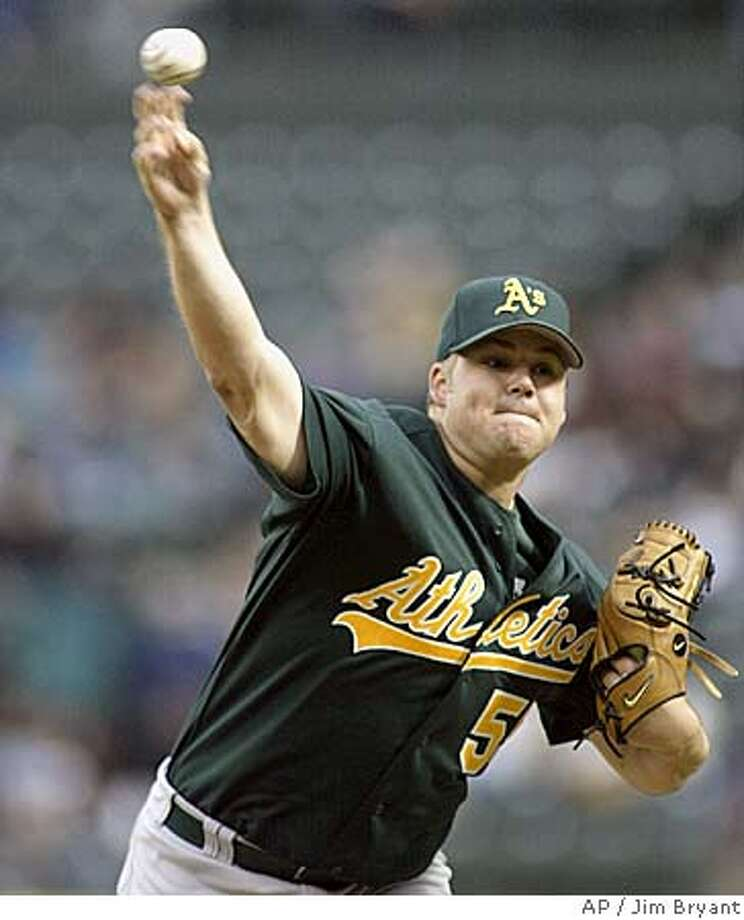 Oakland Athletics starter Joe Blanton pitches to Seattle Mariners' Raul Ibanez (not shown) in the first inning Saturday, Oct.t 1, 2005 in Seattle. (AP Photo/Jim Bryant) Photo: JIM BRYANT