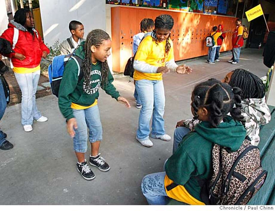Ariel Cosby (left) and Aseelah Bolden dance for their fifth-grade classmates when Peralta Elementary School students returned to classes at the old Carter Middle School in Oakland, Calif. on Tuesday, April 3, 2007. School administrators relocated Peralta to the old Carter Middle School campus after a fire heavily damaged Peralta one week ago. Carter Middle School was vacant after the district closed the school last June.  PAUL CHINN/The Chronicle  **Ariel Cosby, Aseelah Bolden Photo: PAUL CHINN