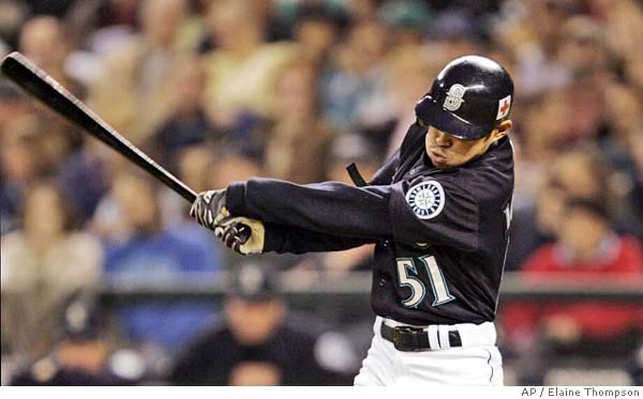 Seattle Mariners' Ichiro Suzuki singles against the Oakland Athletics in the sixth inning, Friday, Sept. 30, 2005, in Seattle. The hit was Suzuki's 201st of the season. He's become the sixth player in Major League history to collect at least 200 hits in five-straight seasons. (AP Photo/Elaine Thompson) Photo: ELAINE THOMPSON