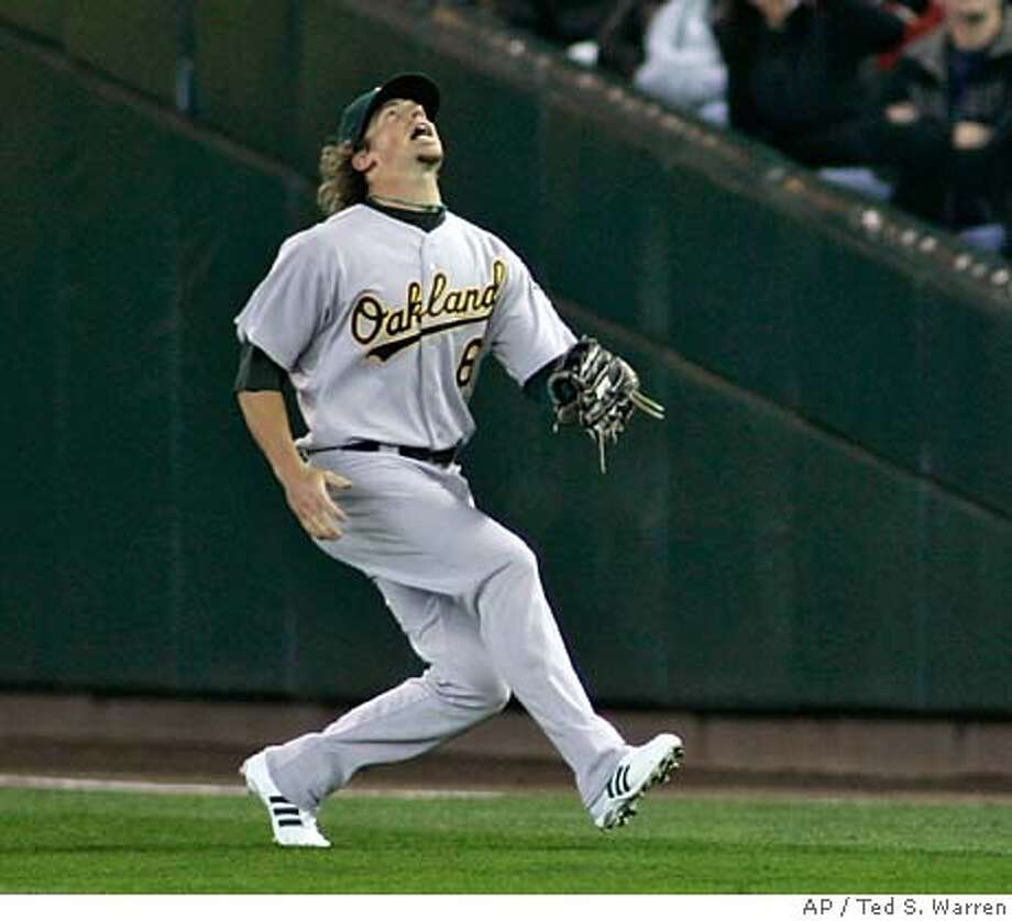 Oakland Athletics right fielder Travis Buck chases down a fly hit by Seattle Mariners' Yuniesky Betancourt for an out Monday, April 2, 2007, on MLB baseball opening day at Safeco Field in Seattle. The Mariners beat the A's 4-0. (AP Photo/Ted S. Warren) Photo: Ted S. Warren