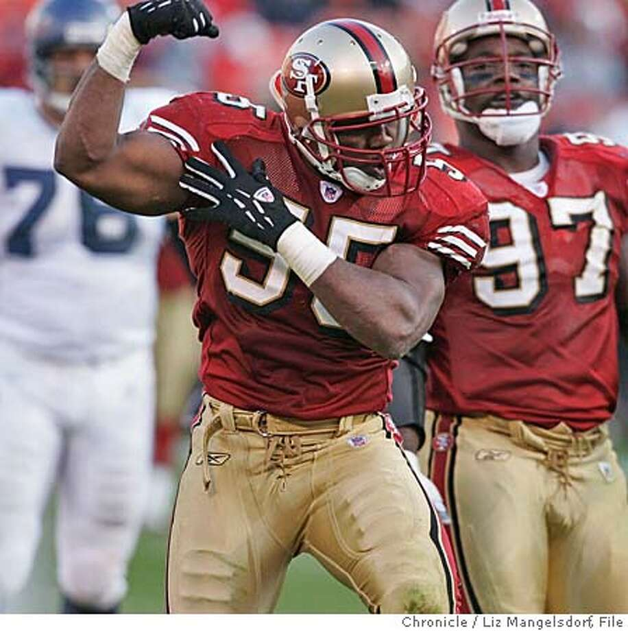 _L8G0232.JPG Event on 11/7/04 in San Francisco. Niner #55 Jamie Winborn celebrates a tackle in the fourth quarter that resulted in a punt by the seahawks. The Seattle Seahawks beat the San Francisco 49ers at monster park.  Liz Mangelsdorf / The Chronicle Photo: Liz Mangelsdorf
