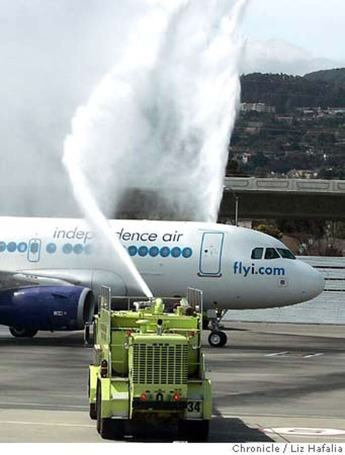 INDEPENDENCE04_007_LH.JPG Independence Air, a low-cost carrier based in Virginia, is launching twice a day service from San Francisco International Airport to Washington airport. Shot in Millbrae on 5/3/05. A stream of water from a fire truck welcomes an Independence Air jet to San Francisco. The discount carrier began service from SFO to Washington Dulles on Sunday. Creditted to San Francisco Chronicle/Liz Hafalia Photo: Liz Hafalia