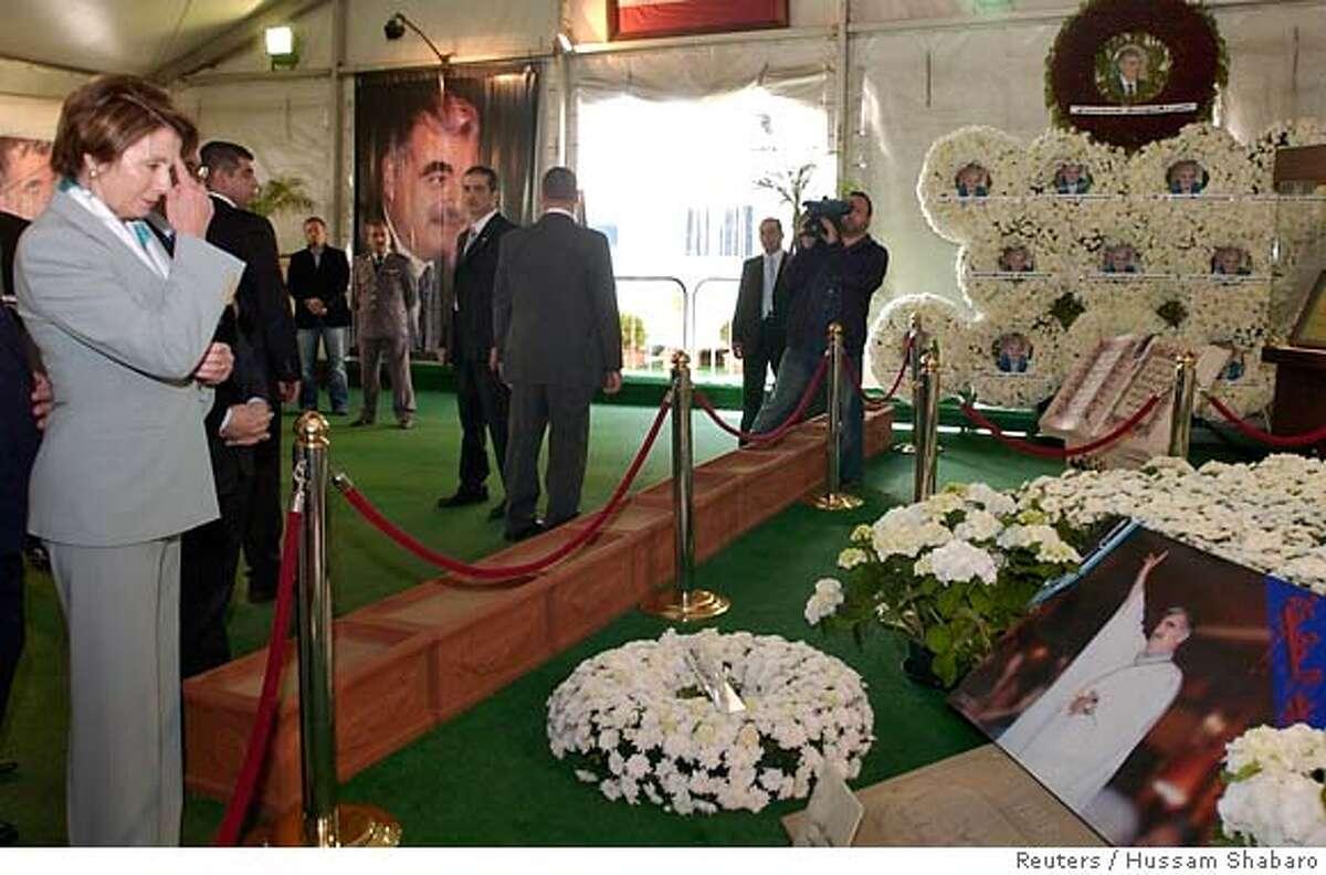 U.S. House Speaker Nancy Pelosi prays at the grave of Lebanon's assassinated former prime minister Rafik al-Hariri in Beirut April 2, 2007. REUTERS/Hussam Shabaro (LEBANON) 0