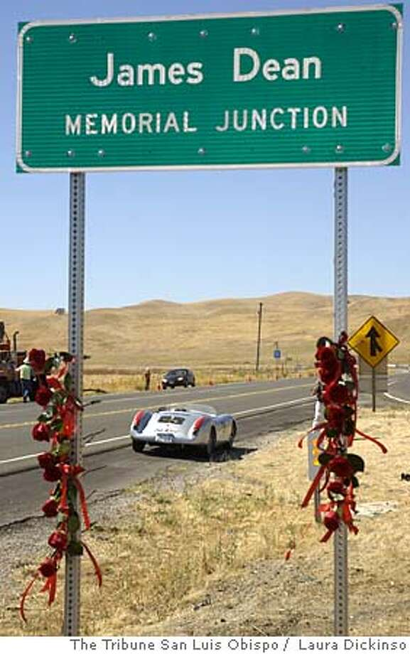 Dozens of people attended as the San Luis Obispo County Caltrans workers uncovered new James Junction signs, which are located on Highway 46 near the intersection where Dean died 50 years ago. This is the sign located on the westbound side of Highway 46. Vic Bert, brought a silver Porsche which is a replica of the Porsche dean drove.  Photo by: Laura Dickinson/ Member Ap/ The Tribune San Luis Obispo Photo: Laura DIckinson