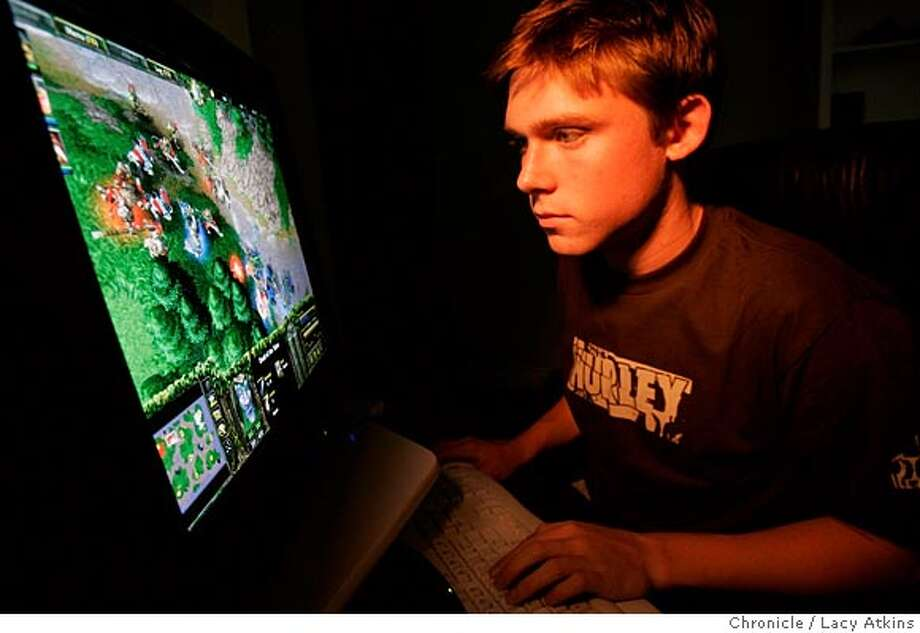 Video game champion Jeff Bliss of Atherton has made the U.S. team for the World Cyber Games in Singapore in November. Bliss, a junior at Menlo-Atherton, earned his spot earlier this month at the U.S. championships in New York. And you thought your kids wouldn't get anywhere playing video games all day. Photographer Lacy Atkins Photo: Lacy Atkins