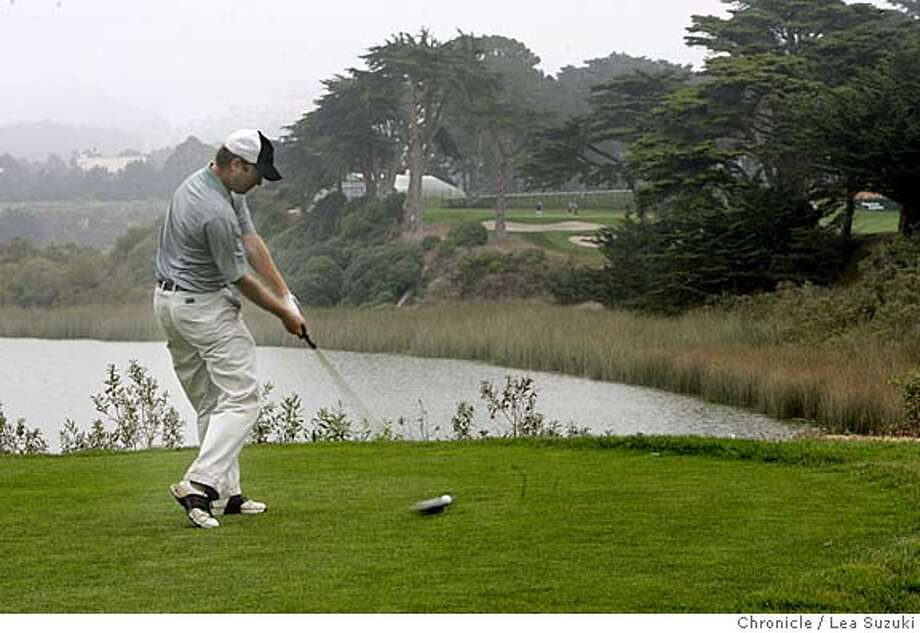 hardingpark_ls_103.JPG  Tyler Lincoln, of San Francisco, tees off on 18th hole with water in background and hole with flag over on the other side.  Need photos of Harding Park Golf Course for upcoming stories setting up American Express pro tournament there in early October. For story that will run sunday sept. 25, need shots of the narrow fairways and long rough. The holes that will be mentioned prominently in that story are the 4th, 14th and 18th. In addition, we'll need scenic photos, including the 18th, which involves a tee shot across lake merced. Plus the signature cypress trees that line the side of holes 14-17 will make great photos we can use in the next two weeks. Photo taken on 9/21/05 in San Francisco, CA. Photo by Lea Suzuki/ The San Francisco Chronicle Photo: Lea Suzuki