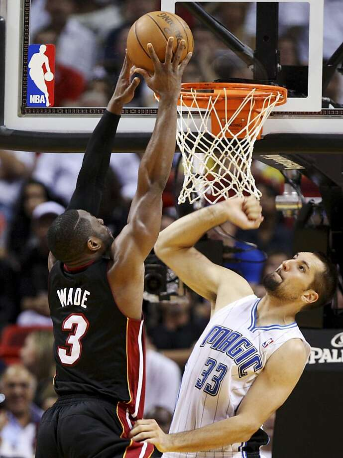 Miami Heat's Dwyane Wade (3) shoots over Orlando Magic's Ryan Anderson (33) during the first half of an NBA basketball game, Sunday, March 18, 2012, in Miami. (AP Photo/Lynne Sladky) Photo: Lynne Sladky, Associated Press
