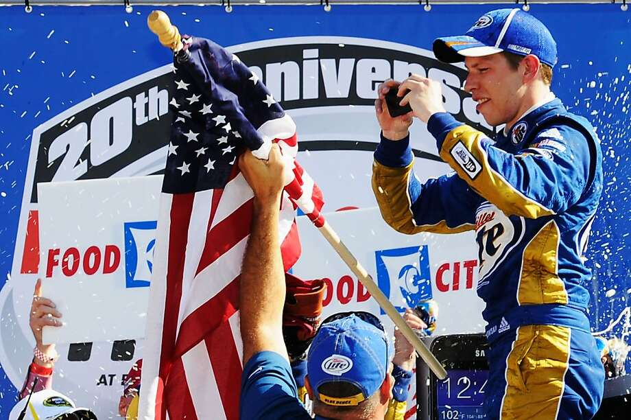 """BRISTOL, TN - MARCH 18:  Brad Keselowski, driver of the #2 Miller Lite Dodge, takes a picture to """"tweet"""" as he celebrates in Victory Lane after winning the NASCAR Sprint Cup Series Food City 500 at Bristol Motor Speedway on March 18, 2012 in Bristol, Tennessee.  (Photo by John Harrelson/Getty Images for NASCAR) Photo: John Harrelson, Getty Images For NASCAR"""