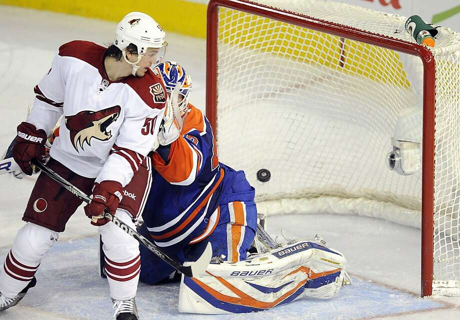 Phoenix Coyotes' Antoine Vermette looks as the shot from teammate Ray Whitney enters the net behind Edmonton Oilers goaltender Devan Dubnyk during the third period of an NHL hockey game in Edmonton, Alberta, on Sunday, March 18, 2012. (AP Photo/The Canadian Press, John Ulan) Photo: John Ulan, Associated Press