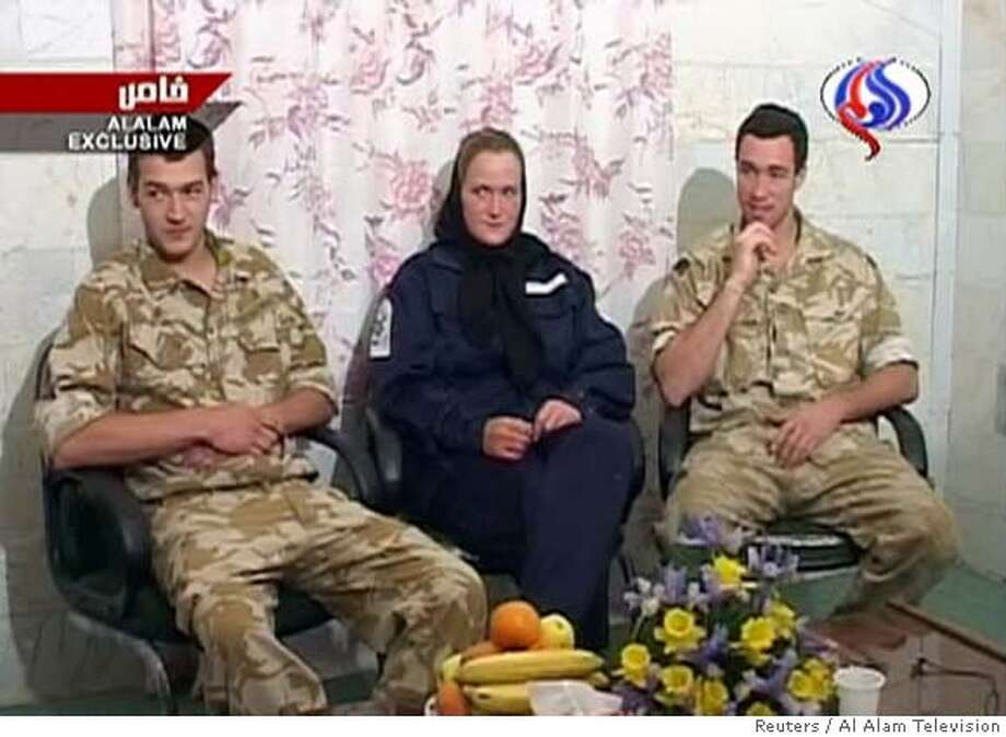 A frame grab from Iranian TV shows three of 15 captured British sailors and marines speaking on Iranian television March 30, 2007. Iranian television broadcast the footage of the three on Friday and said one had confessed to entering Iranian waters illegally and had apologised to the Iranian people. REUTERS/Al Alam Television (IRAN) IRAN OUT Photo: REUTERS TV