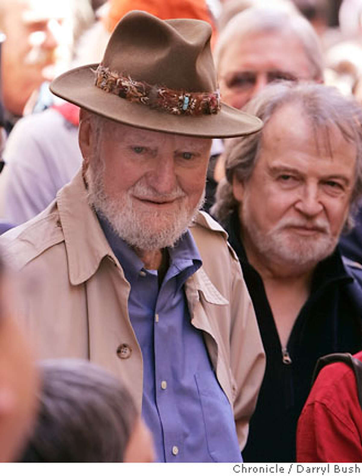 Poet Lawrence Ferlinghetti, owner of City Lights Bookstore, with friend, conductor George Cleve of Berkeley, back right, talks to many fans of his poetry as he attends with a crowd of hundreds at the Jack Kerouac Alley Dedication for the newly restored Jack Kerouac Alley between Grant and Coumbus in North Beach, which was attended by community leaders and local residents from North Beach and Chinatown and included entertainment and festivities from 12:00 to 4:00 p.m. in San Francisco, CA, on Saturday, March, 31, 2007. photo taken: 3/31/07 Darryl Bush / The Chronicle ** Lawrence Ferlinghetti (cq)