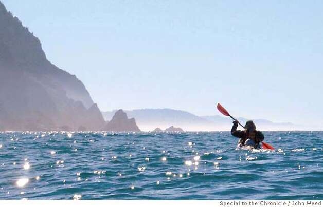 Paul McHugh paddles south out of Bear Harbor.  Rediscovering California's North Coast. A kayak voyage by Paul McHugh, Bo Barnes and John Weed. A paddle from the Oregon border to the SF bay.  Photo taken on 9/25/05 in Bear Harbor, CA by John Weed / special for the San Francisco Chronicle Photo: John Weed