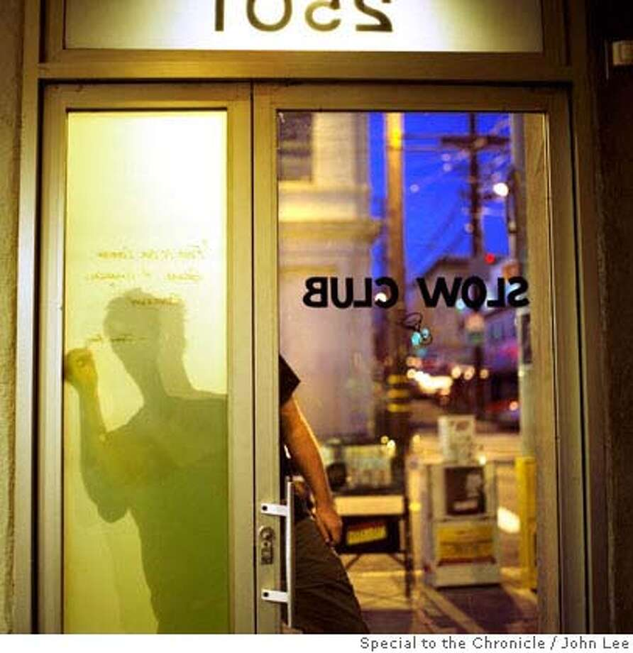TOP 100 SLOW CLUB 05.jpg Server Rob Glees (cq) writes a quote from James Beard on a window at the entrance to Slow Club in San Francisco's Mission District. By JOHN LEE/SPECIAL TO THE CHRONICLE Photo: JOHN LEE