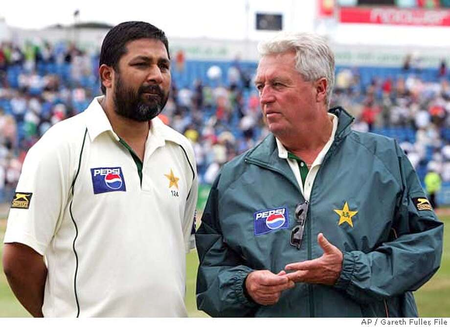 ** FILE ** Pakistan captain Inzamam-ul-Haq, left, stands beside Pakistan World Cup cricket coach Bob Woolmer in this August 8, 2006 file photo. Two Pakistani team members were being questioned Saturday March 24, 2007 by Jamaican police investigating the murder of World Cup cricket coach Bob Woolmer, but the men have not been detained, according to the team's spokesman. Pakistan captain Inzamam-ul-Haq and assistant coach Mushtaq Ahmed were being questioned by Jamaican investigators in the Montego Bay hotel where the cricket team is staying, spokesman Pervez Jamil Mir told reporters. (AP Photo/ Gareth Fuller/PA, File) ***NO MOBILE USE, EDITORIAL USE ONLY, UNITED KINGDOM OUT NO SALES NO ARCHIVE *** NO MOBILE USE, EDITORIAL USE ONLY, UNITED KINGDOM OUT NO SALES NO ARCHIVE - PHOTOGRAPH CAN NOT BE STORED OR USED FOR MORE THAN 14 DAYS AFTER THE DAY OF TRANSMISSION - AUGUST 8, 2006 FILE PHOTO Photo: Gareth Fuller