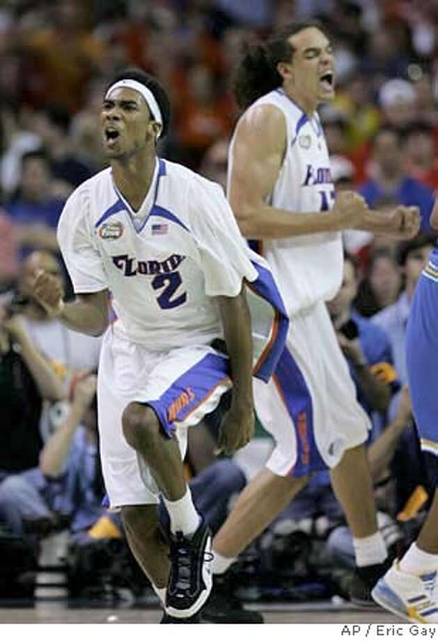 Florida's Corey Brewer (2) reacts after hitting a three pointer with teammate Joakim Noah during the second half of a Final Four semifinal basketball game against UCLA at the Georgia Dome in Atlanta, Saturday, March 31, 2007. (AP Photo/Eric Gay) Photo: Eric Gay