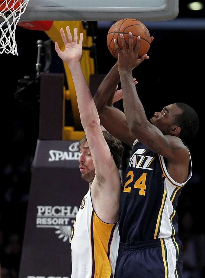 Utah Jazz forward Paul Millsap (24) shoots over Los Angeles Lakers forward Pau Gasol, left, of Spain, during the first half of an NBA basketball game in Los Angeles, Sunday, March 18, 2012. (AP Photo/Alex Gallardo) Photo: Alex Gallardo, Associated Press