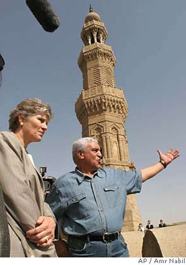 Karen Hughes, US undersecretary of state for public diplomacy and public affairs, left, listens to Zahi Hawas, the head of Egypt supreme antiquites council, as she visits Cairo's old city Sunday, Sept.25, 2005. Hughes' trip is part of efforts to counter negative attitudes about U.S. policies in the Middle East. (AP Photo/Amr Nabil) Photo: AMR NABIL