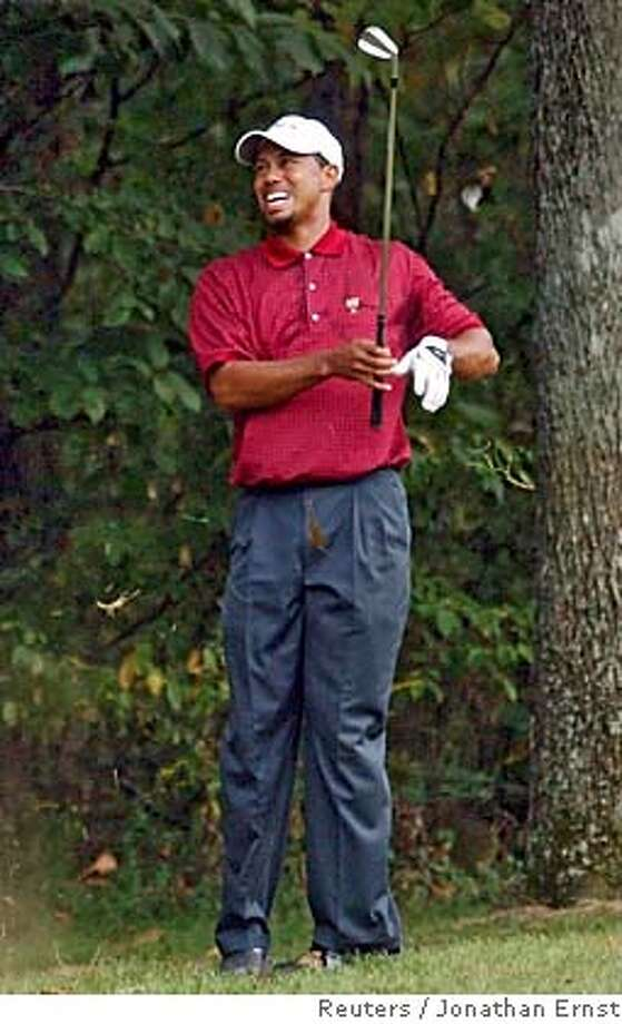 Tiger Woods of the U.S. reacts as he hits out of the rough on the 17th hole during his singles match against South African Retief Goosen at the Presidents Cup in Gainesville, Virginia September 25, 2005. Though Woods lost his match, the American team went on to defeat the International team 18-1/2 to 15-1/2. REUTERS/Jonathan Ernst 0 Photo: JONATHAN ERNST