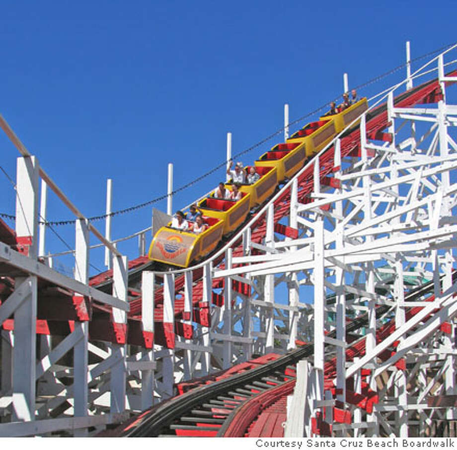 TRAVEL SANTA CRUZ -- Hand out photo from the Giant Dipper rollercoaster at Santa Cruz Beach Boardwalk in Santa Cruz, Calif. Hand out: Courtesy Santa Cruz CVB???  Ran on: 04-01-2007  Visitors to Santa Cruz's boardwalk this year will get more than historic thrill rides as the attraction celebrates its 100th birthday. Photo: Tk