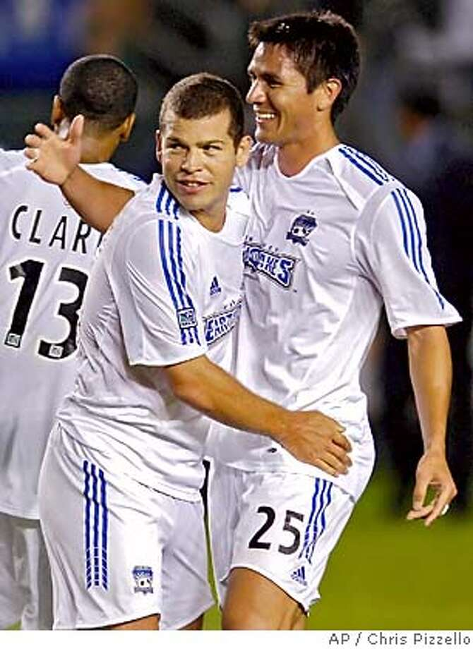 San Jose Earthquakes' Alejandro Moreno, left, is congratulated by teammate Brian Ching after scoring the decisive goal late in the second half against Chivas USA in Carson, Calif., Saturday, Sept. 17, 2005. San Jose won the game, 2-1. (AP Photo/Chris Pizzello) Photo: CHRIS PIZZELLO