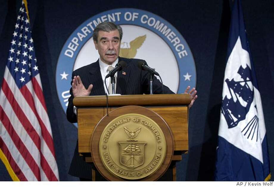 Commerce Secretary Carlos Gutierrez speaks at a news conference at the Commerce Department in Washington, Friday, March 30, 2007. (AP Photo/Kevin Wolf) Photo: Kevin Wolf
