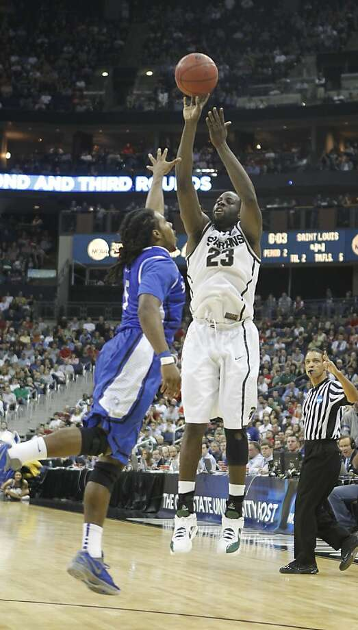 Michigan State's Draymond Green hits a jumper over Saint Louis Jordair Jett late in the second half of a third-round game in the NCAA Tournament at Nationwide Arena in Columbus, Ohio, Sunday, March 18, 2012. MSU defeated Saint Louis, 65-61. (Julian H. Gonzalez/Detroit Free Press/MCT) Photo: Julian H. Gonzalez, McClatchy-Tribune News Service