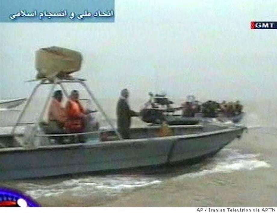A vessel approaches what appears to be a boat with British servicemen aboard Friday, March 23, 2007 in this image taken from Iranian television. Iranian television released a few seconds of footage on Thursday, March 29, 2007 showing what it said was the operation that seized a British Royal Navy crew last week. In the footage, made available by Associated Press Television News, gunshots were heard and a helicopter was shown hovering above inflatable boats. (AP Photo/ Iranian Television via APTN) ** IRAN OUT TV OUT ** TV OUT IRAN OUT Photo: Iranian Television Via APTN