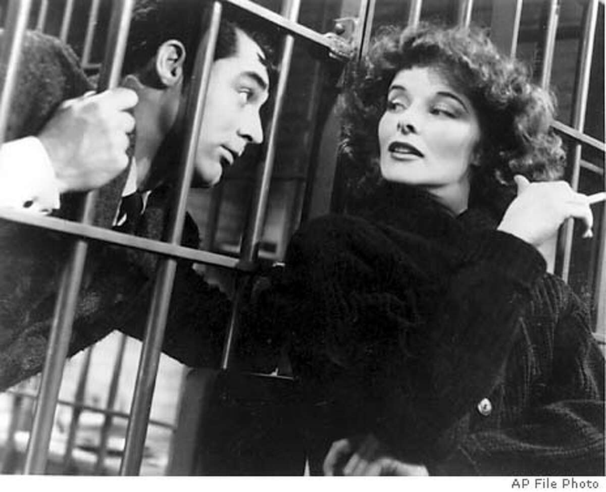 """** FILE ** Actress Katharine Hepburn is shown in character with Cary Grant in a scene from """"Bringing Up Baby"""" in 1938. Hepburn, an icon of feminist strength and spirit who brought a chiseled beauty and patrician bearing to such films as ``The Philadelphia Story'' and ``The African Queen,'' died Sunday, June 29, 2003 her executor and town authorities said. She was 96. (AP Photo) (AP Photo)"""