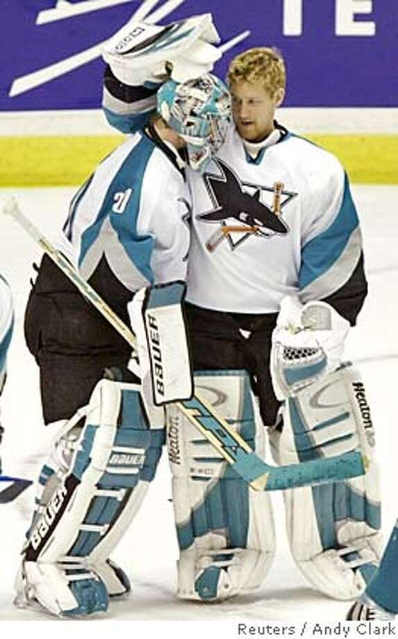 San Jose Sharks goalie Evgeni Nabokov (L) is congratulated by teammate Vesa Toskala after notching a shutout in Game 3 of their NHL Western Conference final against the Calgary Flames in Calgary, May 13, 2004. The Sharks defeated the Flames 3-0 to put the series at two games to one for the Flames. REUTERS/Andy Clark Reserve goalie Vesa Toskala (right), congratulating Evgeni Nabokov after Game 3, has been little more than a cheerleader. Reserve goalie Vesa Toskala (right), who congratulates Evgeni Nabokov after Game 3, has been little more than a cheerleader. Ran on: 09-18-2006  Vesa Toskala took over the No. 1 goalie position in midseason and led the Sharks into the playoffs. 0 Photo: ANDY CLARK