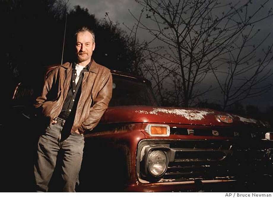 """� ** EDITORS PLEASE CORRECT YEAR OF DEATH TO 2004, NOT 2000, AS SENT ** ADVANCE FOR WEEKEND, MARCH 23-25 ** FILE ** Author Larry Brown poses March 19, 2000, near Oxford, Miss. Brown, who wrote about the often rough, gritty lives of rural Southerners, died in November 2004. His unfinished final novel, """"The Miracle of Catfish, """" will be published in March 2007, with notes from Brown on a proposed ending. (AP Photo/The Oxford Eagle, Bruce Newman, File) EDITORS PLEASE CORRECT DEATH DATE TO 2004, NOT 2000, AS SENT. ADVANCE FOR WEEKEND, MARCH 23-25. FILE PHOTO OF MARCH 19, 2000. PHOTO MAGS OUT. NO SALES"""