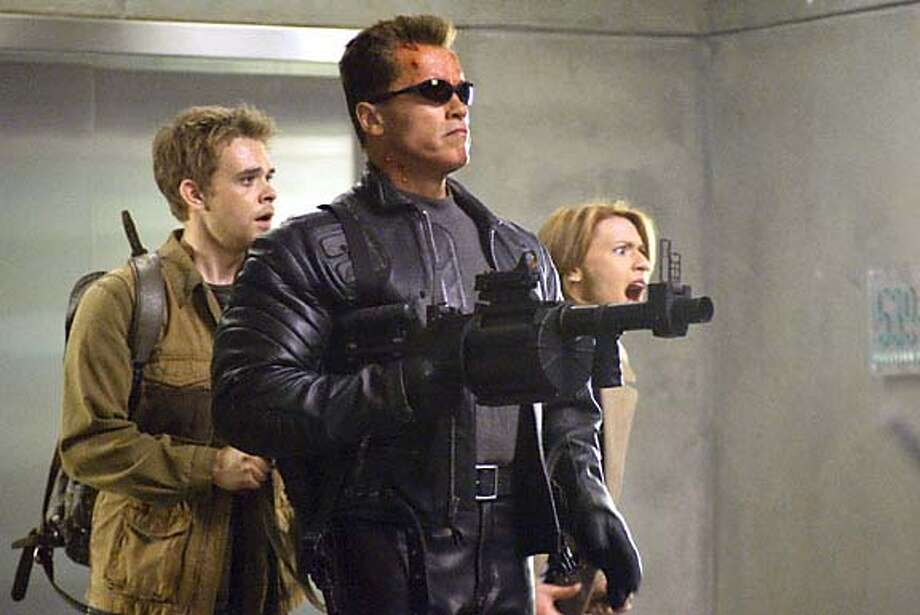 """TERMINATOR3  (L-r) NICK STAHL, ARNOLD SCHWARZENEGGER and CLAIRE DANES in the futuristic action thriller """"Terminator 3: Rise of the Machines,"""" distributed by Warner Bros. Pictures.  PHOTOGRAPHS TO BE USED SOLELY FOR ADVERTISING, PROMOTION, PUBLICITY OR REVIEWS OF THIS SPECIFIC MOTION PICTURE AND TO REMAIN THE PROPERTY OF THE STUDIO. NOT FOR SALE OR REDISTRIBUTION Photo: HO"""