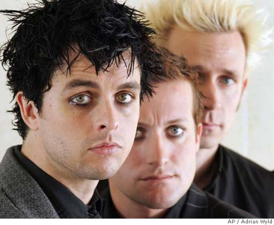 **FILE**Members of Green Day, Billie Joe Armstrong ,left, Tre Cool and Mike Dirnt ,right, pose for a photo between interviews in Toronto on Sept. 23, 2004.The group, Alicia Keys, Tim McGraw and U2 will perform at the 47th annual Grammy Awards next month. (AP Photo/CP,Adrian Wyld) Ran on: 02-13-2005  Usher: This could be his year at the Grammys. ALSO Ran on: 08-28-2005  Green Day, with Billie Joe Armstrong, left, is coming to SBC Park in September. A SEPT 23 2004 FILE PHOTO Photo: ADRIAN WYLD
